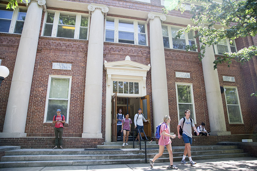 Historic Peabody hall in spring as students leave during a class change